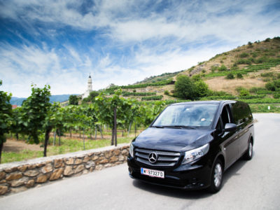 Drive with luxury van through vineyards at Wachau Valley