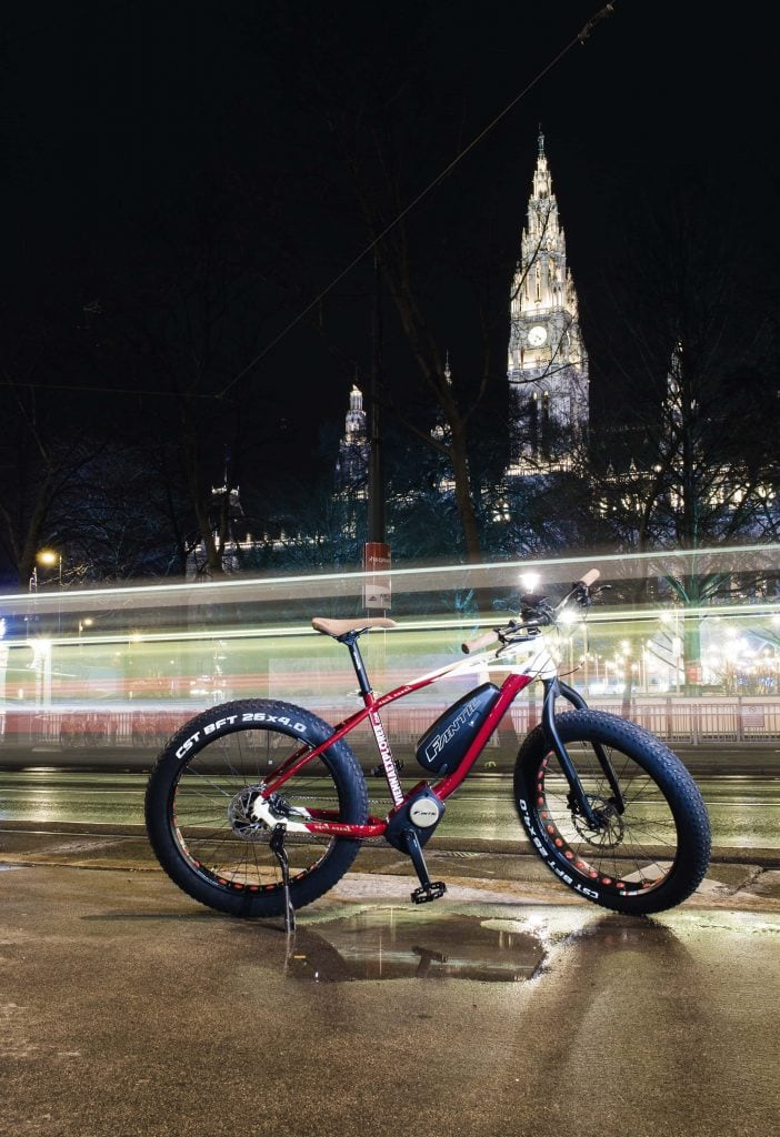 bike parked in front of Rathaus at night