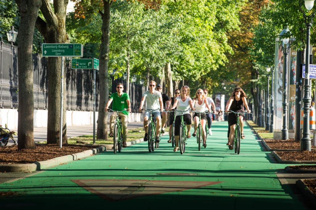 Group biking on Vienna Ring road on a guided tour